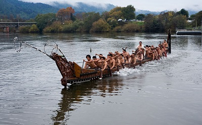 Maori People in Canoe