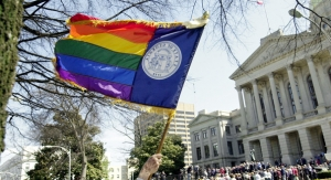 "A demonstrator against the gay marriage amendment waves a ""rainbow"" Georgia flag at a rally in support of the amendment on the Capitol steps during tandem demonstrations for and against the amendment in Atlanta, Monday, March 1, 2004. The two groups were kept apart by law enforcement officers. (AP Photo/Ric Feld)"